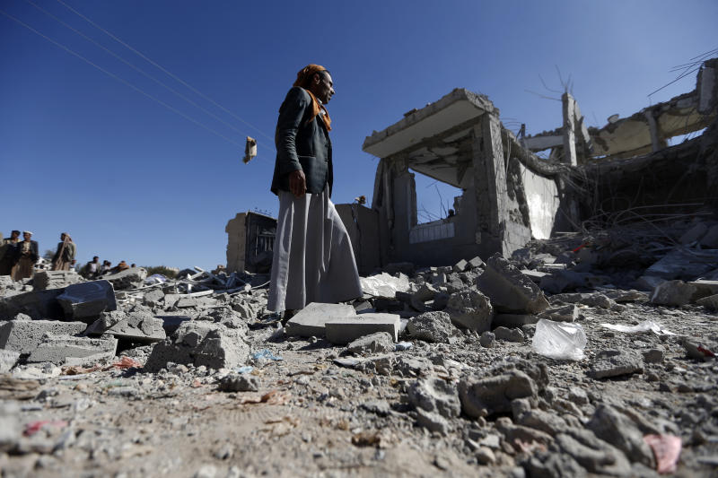 Checking the damage in the aftermath of a reported airstrike on San'a by the Saudi-led coalition.