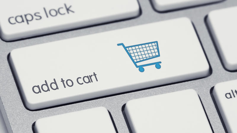 A computer keyboard button labeled add to cart with a picture of a shopping cart on it