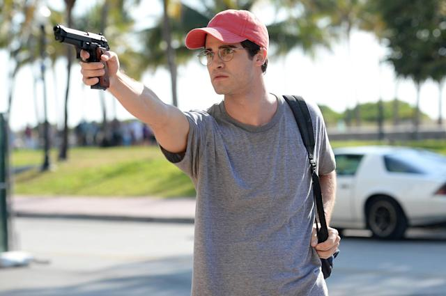 Cunanan, wearing a red baseball cap, readies to kill Versace in  <em>The Assassination of Gianni Versace</em>. (Photo: Jeff Daly/FX)