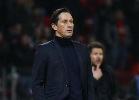 Bayer Leverkusen coach Roger Schmidt and Atletico Madrid coach Diego Simeone