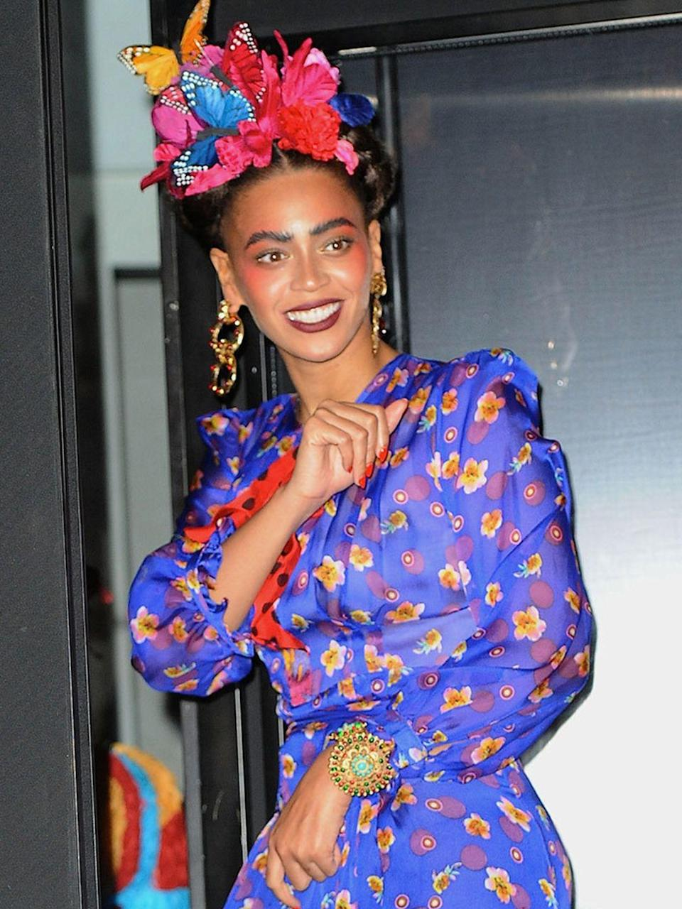 <p>Beyoncé as Frida Kahlo as she spends Halloween night 2014 out at Charlie Bird in NYC, with a front-row view of the Halloween Parade.</p>