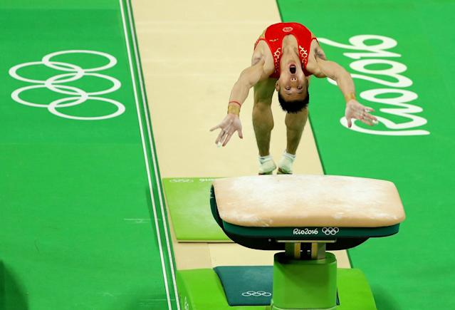 <p>Chenglong Zhang of China vaults during the Artistic Gymnastics Men's Team qualification on Day 1 of the Rio 2016 Olympic Games at Rio Olympic Arena on August 6, 2016 in Rio de Janeiro, Brazil. (Photo by Scott Halleran/Getty Images) </p>