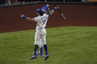 Los Angeles Dodgers' Cody Bellinger celebrates his home run with A.J. Pollock against the Atlanta Braves during the seventh inning in Game 7 of a baseball National League Championship Series Sunday, Oct. 18, 2020, in Arlington, Texas. (AP Photo/Sue Ogrocki)