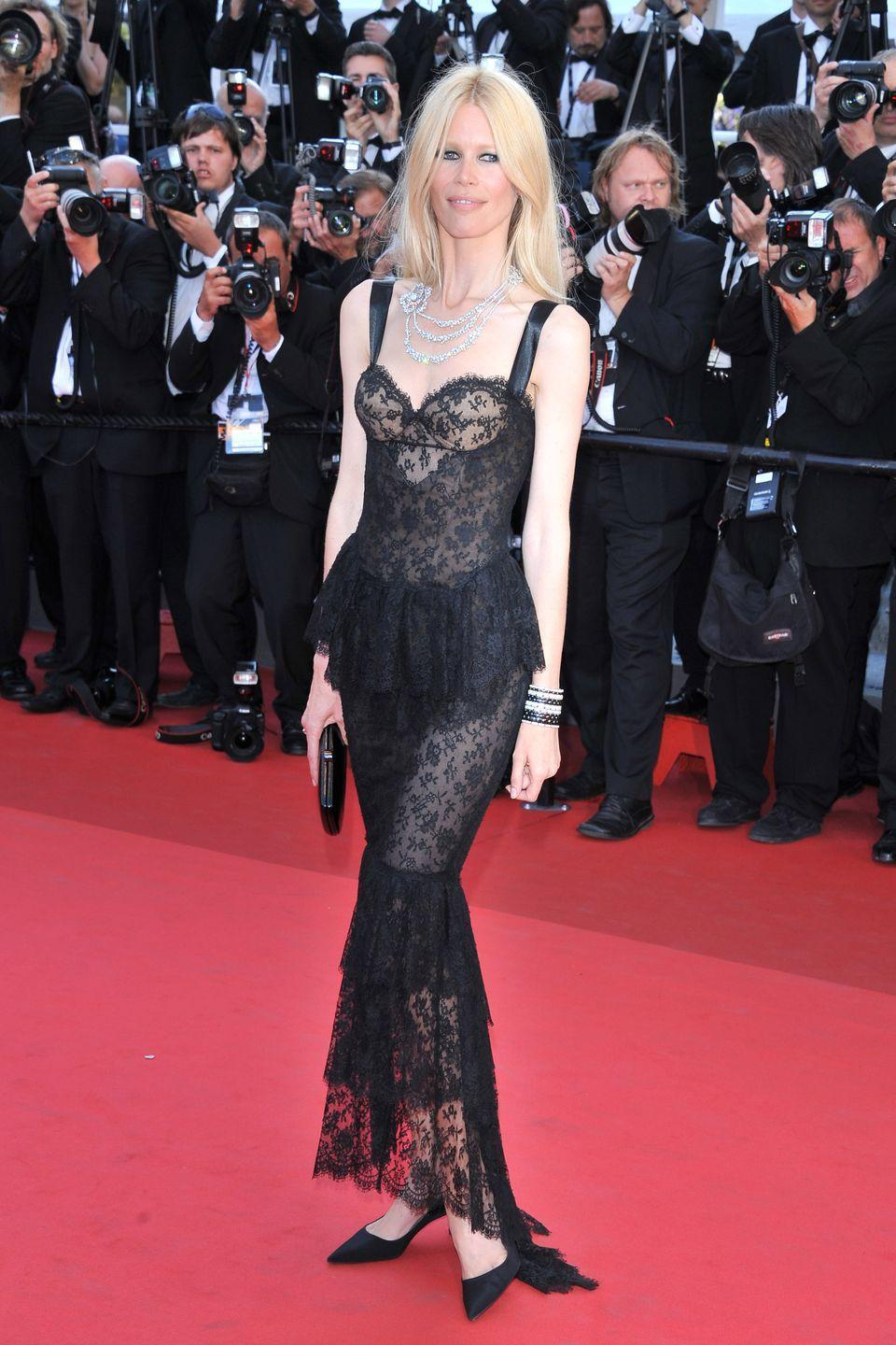 "<p>At the Cannes Film Festival for the screening of the film ""This must be the Place"" by Paolo Sorrentino in May 2011 wearing a Chanel sheath Haute Couture dress in black lace with a ""Camélia Poudré"" necklace and a black cuff ""Ultra"" Chanel Fine Jewellery.</p>"