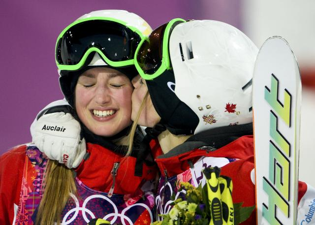Canada's Chloe Dufour-Lapointe (L) and her sister Justine celebrate in the finish area during the women's freestyle skiing moguls final competition at the 2014 Sochi Winter Olympic Games in Rosa Khutor, February 8, 2014. REUTERS/Dylan Martinez (RUSSIA - Tags: SPORT OLYMPICS SPORT SKIING)