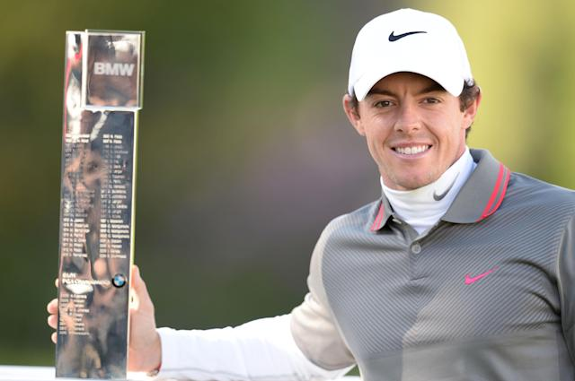 Northern Ireland's Rory Mcilroy celebrates winning the BMW PGA Championship at the Wentworth Club, Virginia Water, Sunday May 25, 2014. (AP Photo/ PA, Adam Davy)
