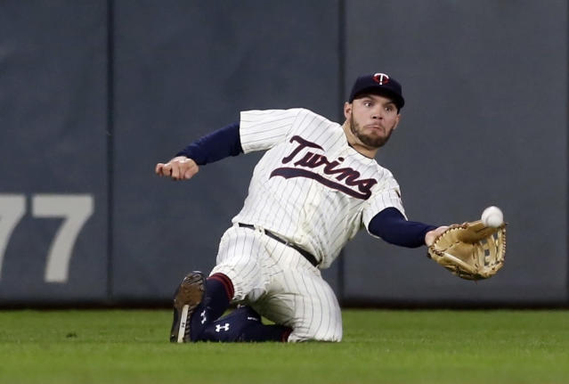 Minnesota Twins left fielder Johnny Field makes a sliding catch of a fly ball off the bat of Detroit Tigers' JaCoby Jones during the fifth inning of a baseball game Wednesday, Sept. 26, 2018, in Minneapolis. (AP Photo/Jim Mone)