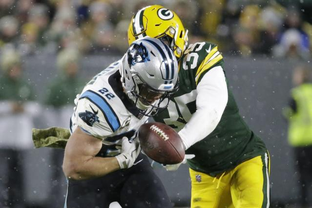 Green Bay Packers' Ibraheim Campbell forces a fumble by Carolina Panthers' Christian McCaffrey during the second half of an NFL football game Sunday, Nov. 10, 2019, in Green Bay, Wis. McCaffrey recovered his own fumble. (AP Photo/Mike Roemer)