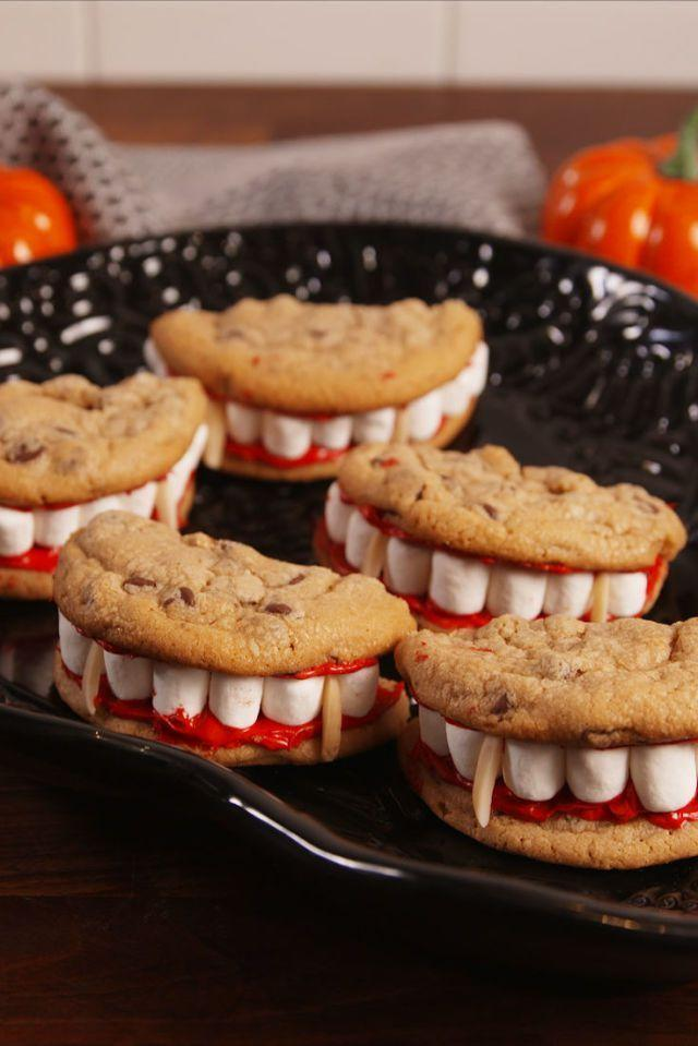 """<p>This recipe comes together with just a couple of mini marshmallows, chocolate chip cookies, and red frosting.</p><p><em><strong>Get the recipe at <a href=""""https://www.delish.com/cooking/recipe-ideas/recipes/a55668/dracula-dentures-recipe/"""" rel=""""nofollow noopener"""" target=""""_blank"""" data-ylk=""""slk:Delish"""" class=""""link rapid-noclick-resp"""">Delish</a>.</strong></em></p>"""