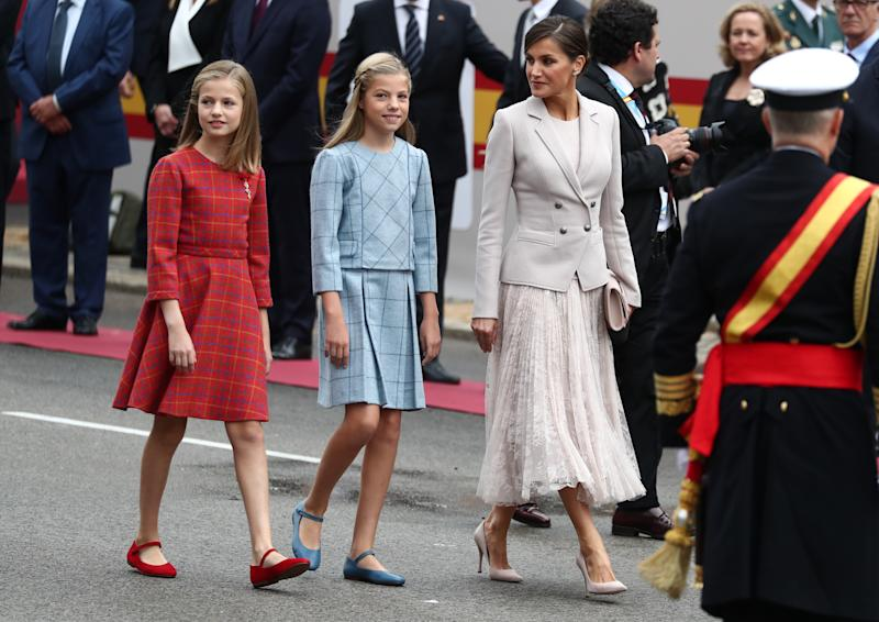 Spain's Queen Letizia and daughters Princesses Sofia and Leonor arrive to attend a parade as part of celebrations to mark Spain's National Day in Madrid, Spain October 12, 2018. REUTERS/Sergio Perez
