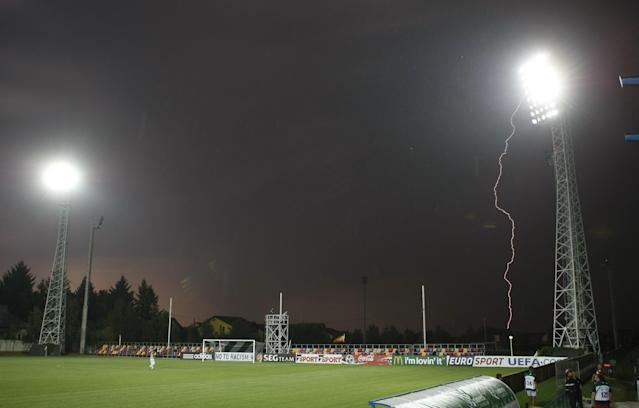 A lightning strikes next to stadium of Mogosoaia during the football final match of the UEFA European Under-19 Championships 2011 between Belgium and Spain in Mogosoaia, near Bucharest, on July 20, 2011. Due to the severe weather conditions the match was postponed for July 21. AFP PHOTO / STRINGER (Photo credit should read STRINGER/AFP/Getty Images)