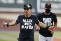 Baltimore Orioles' Andrew Velazquez warms up in a Black Lives Matter jersey before an opening day baseball game against the Boston Red Sox at Fenway Park, Friday, July 24, 2020, in Boston. (AP Photo/Michael Dwyer)