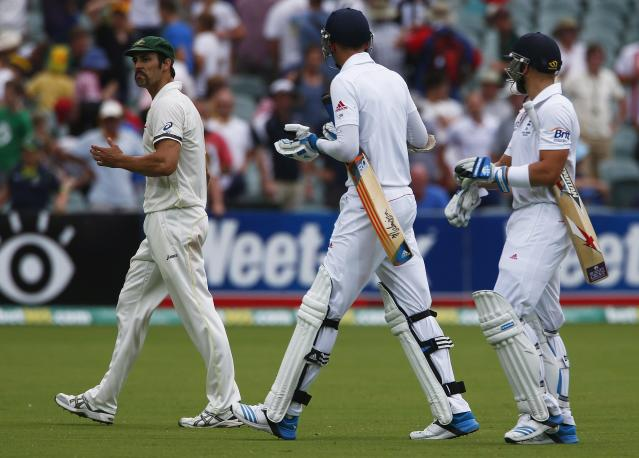 Australia's Mitchell Johnson (L) argues with England's Stuart Broad (C) and Matt Prior at the end of the fourth day's play in the second Ashes cricket test at the Adelaide Oval December 8, 2013. REUTERS/David Gray (AUSTRALIA - Tags: SPORT CRICKET)