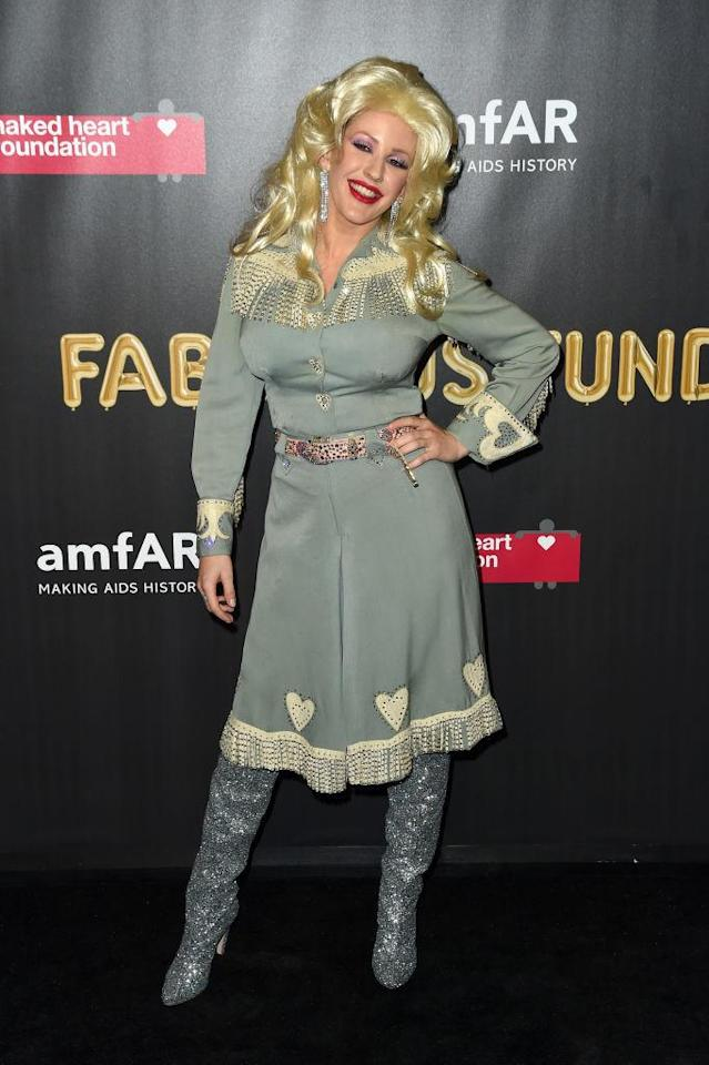 <p>The western dress, the big blonde hair, and the sparkly accessories? Obviously, the singer went as to a charity bash as country music icon Dolly Parton. (Photo: Nicholas Hunt/Getty Images) </p>
