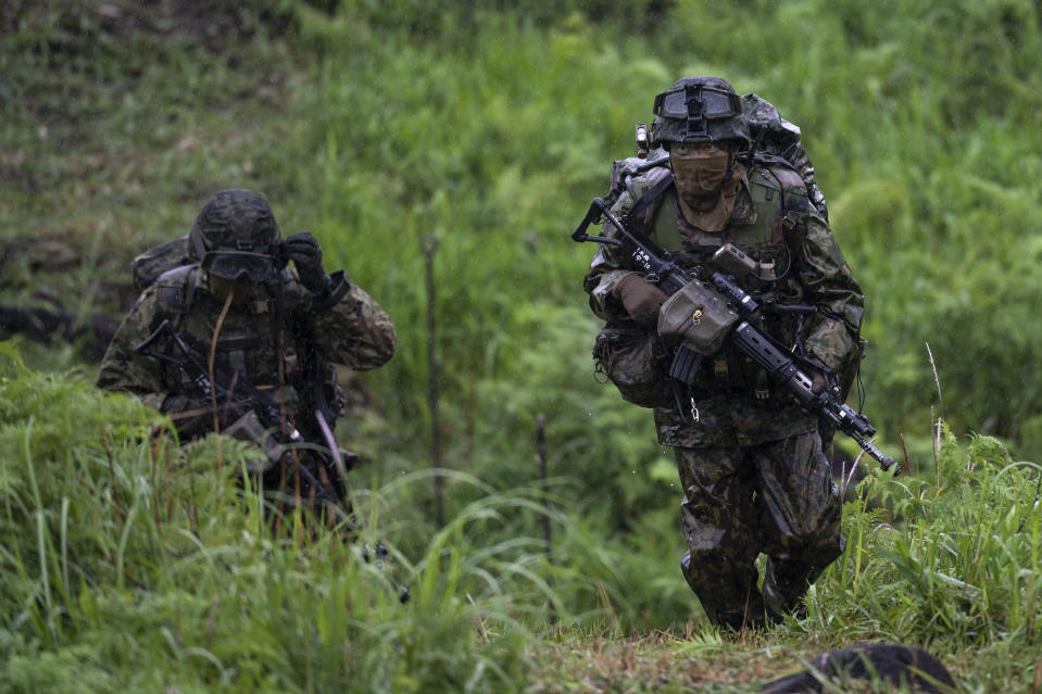 Japan's Self-Defense Force soldiers take part in a joint military drill between Japan Self-Defense Force, French army and U.S. Marines, at the Kirishima exercise area in Ebino, Miyazaki prefecture, southern Japan Saturday, May 15, 2021. (Charly Triballeau/Pool Photo via AP)