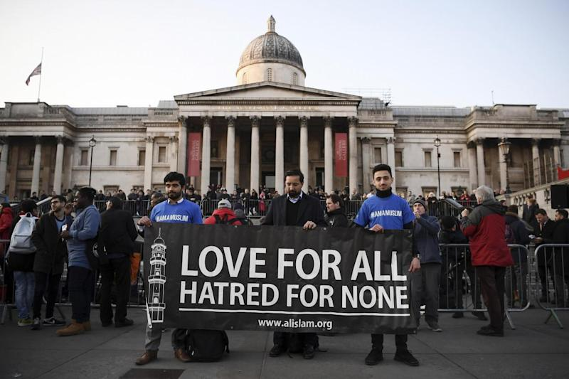Tribute: Supporters hold up a banner ahead of a candlelit vigil at Trafalgar Square (Getty Images)