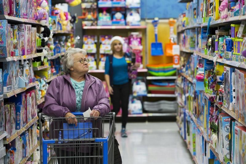 Shoppers look at merchandise at a Walmart store in Secaucus, New Jersey