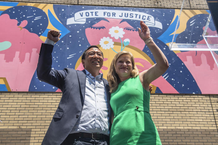 Mayoral candidates Andrew Yang and Kathryn Garcia wave to New Yorkers after speaking at the AAPI Democracy Project's