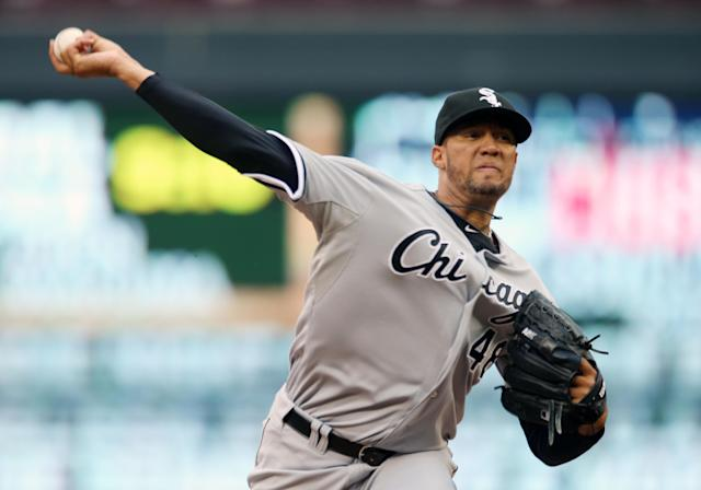 Chicago White Sox pitcher Hector Noesi throws against the Minnesota Twins in the first inning of a baseball game, Thursday, July 24, 2014, in Minneapolis. (AP Photo/Jim Mone)