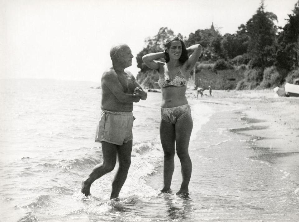 <p>Pablo Picasso and Fracoise Gilot put their feet in the water, circa 1950.</p>