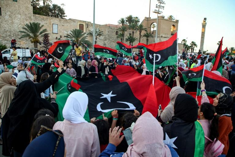 People celebrate on Tripoli's Martyrs' Square on June 5, 2020, after fighters loyal to the UN-recognised Government of National Accord (GNA) captured the town of Tarhuna, about 65 kilometres southeast of the capital from rival forces loyal to strongman Khalifa Haftar
