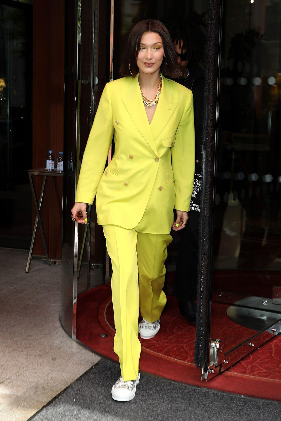 """<p>Wearing a bright yellow suit, heading to the Dior Homme show in Paris. <em><a href=""""http://www.dailymail.co.uk/tvshowbiz/article-5879961/Bella-Hadid-reveals-slender-waistline-tiny-crop-steps-Paris.html"""" rel=""""nofollow noopener"""" target=""""_blank"""" data-ylk=""""slk:The Daily Mail"""" class=""""link rapid-noclick-resp"""">The Daily Mail</a></em> reports that Hadid had a wardrobe malfunction later in the day in the form of a nip slip. </p>"""