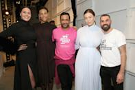 <p>Designers Ramon Martin and Ryan Lobo pose with models from their show wearing Women's March and Planned Parenthood T-shirts. On the runway, models wore Planned Parenthood pins. (Photo: Getty Images) </p>
