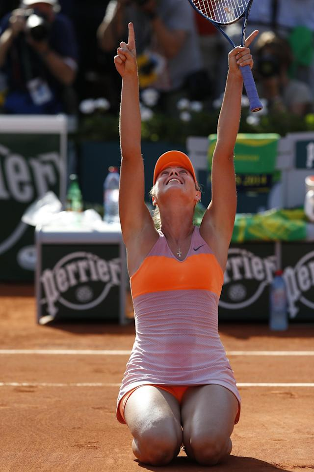 Russia's Maria Sharapova celebrates winning the final of the French Open tennis tournament against Romania's Simona Halep at the Roland Garros stadium, in Paris, France, Saturday, June 7, 2014. Sharapova won in three sets 6-4, 6-7, 6-4. (AP Photo/Darko Vojinovic)