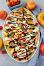 """<p>Why stop at tomatoes, mozzarella, and basil when you can add other seasonal favorites like cucumber and peaches? </p><p><a href=""""https://www.twopeasandtheirpod.com/summer-caprese-salad/"""" rel=""""nofollow noopener"""" target=""""_blank"""" data-ylk=""""slk:Get the recipe."""" class=""""link rapid-noclick-resp"""">Get the recipe. </a></p>"""