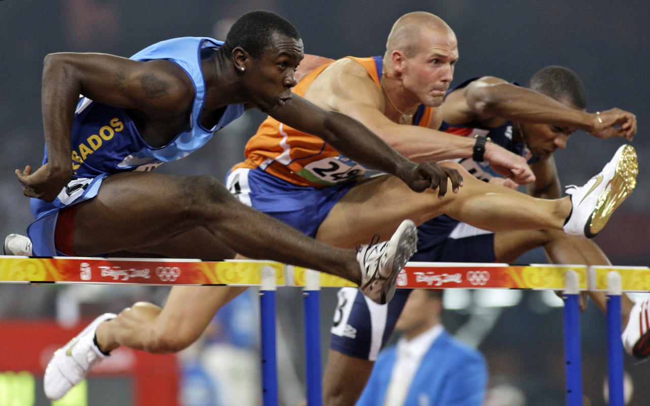 Barbados' Ryan Brathwaite, Netherlands'  Marcel van der Westen and Haiti's Dudley Dorival, from left, compete in a men's 110-meter hurdles 2nd round heat during the athletics competitions in the National Stadium  at the Beijing 2008 Olympics in Beijing, Tuesday, Aug. 19, 2008. (AP Photo/Greg Baker)