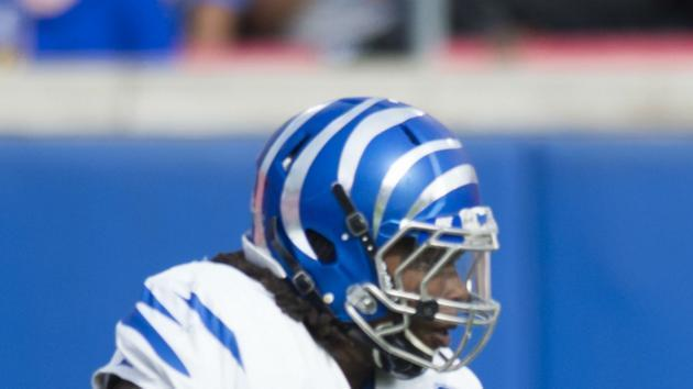 "Memphis football's <a class=""link rapid-noclick-resp"" href=""/college-football/players/275547/"" data-ylk=""slk:JJ Russell"">JJ Russell</a> taken off field on stretcher after scary hit to head vs. UCLA. (Screen shot)"