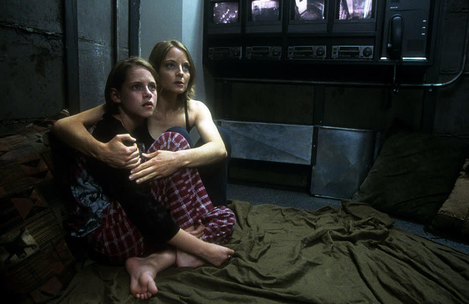 Kristen Stewart is held by Jodie Foster in a scene from the film 'Panic Room', 2002. (Photo by Columbia Pictures /Getty Images)