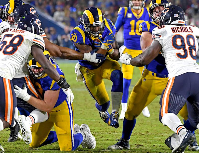 LOS ANGELES, CA - NOVEMBER 17: Running back Todd Gurley #30 of the Los Angeles Rams runs through the Chicago Bears defense in the second half of the game at the Los Angeles Memorial Coliseum on November 17, 2019 in Los Angeles, California. (Photo by Jayne Kamin-Oncea/Getty Images)