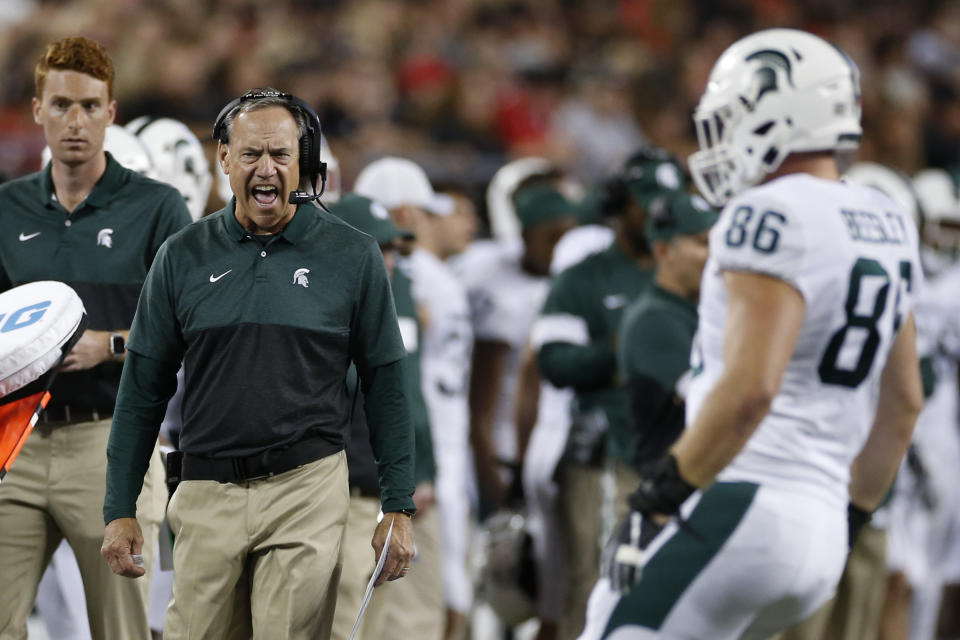 Michigan State coach Mark Dantonio shouts to a player during the first half of the team's game against Ohio State on Oct. 5. (AP)