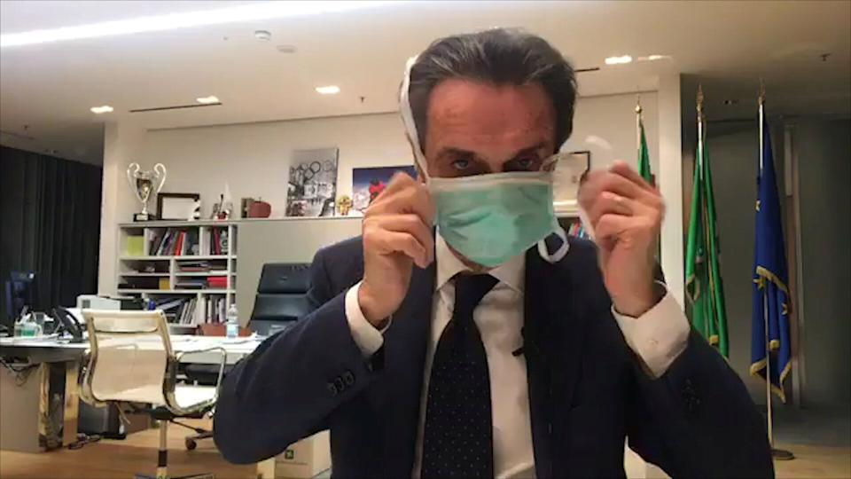 Italy's Lombardy Governor Attilio Fontana puts on a protective mask as he announces on Facebook that he has placed himself in quarantine after one of his aides tested positive for coronavirus, in this still image taken from social media video in Milan, Italy, February 26, 2020. Attilio Fontana Facebook Live/REUTERS TV via REUTERS ATTENTION EDITORS - THIS IMAGE HAS BEEN SUPPLIED BY A THIRD PARTY. (Photo: Reuters TV / Reuters)