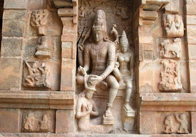 Anugraha Sandeswaramoorthi at Gangaikonda Cholapuram. This is the sculpture of Anugraha Sandeswara Moorthi (Lord Shiva) at Gangaikonda Cholapuram, a masterpece of Chola architectural splendour. It was built by Rajendra Chola, son of the great Rajaraja, from 1012-44. It is a replica of the Big Temple at Thanjavur but with still greater detail and perfection. This was the capital of the Cholas during the reign of Rajendra Chola. Visitors should not miss this beautiful sculpture near the north entrance, depicting Shiva and Parvathi garlanding the saint Sandeswara.