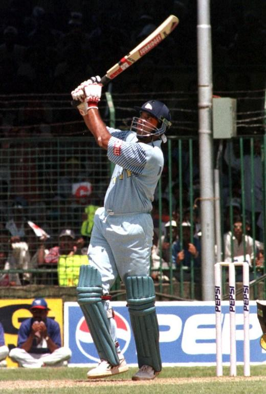 India's new middle order batsman Amay Khurasia hits a might six off Sri Lankan bowler Upul Chandana 30 March 1999 at the Nehru Stadium in Pune. Indian beat Sri Lanka and have progressed to the finals of the Pepsi Cup.   AFP PHOTO/Sebastian D'SOUZA