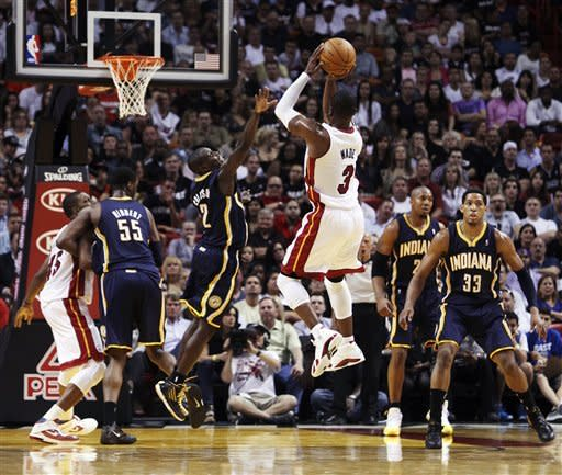 Indiana Pacers' Darren Collison (2) defends a shot by Miami Heat's Dwyane Wade (3) during the first half of a NBA basketball game in Miami, Saturday, March 10, 2012. (AP Photo/J Pat Carter)