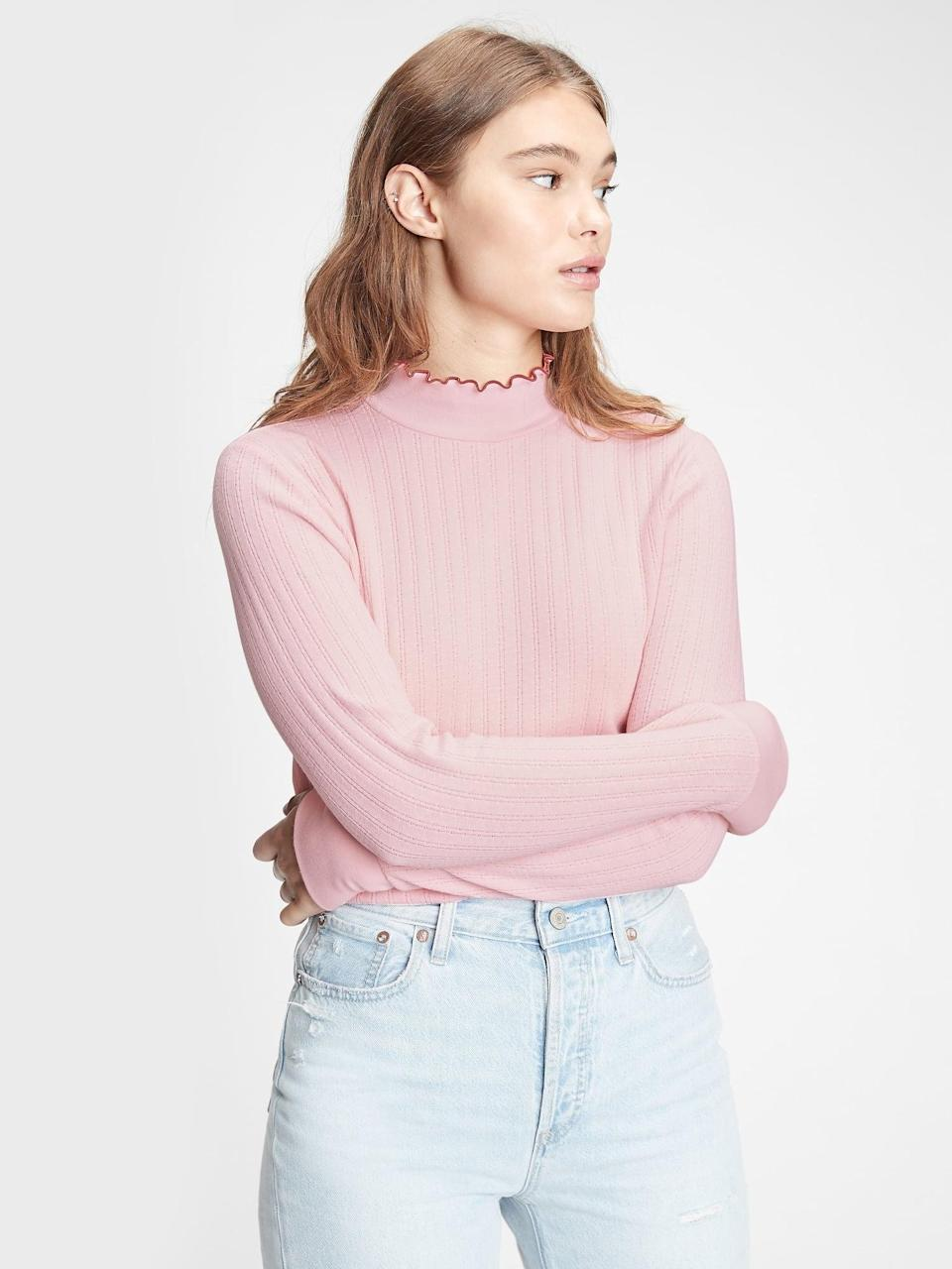 <p>This <span>Gap Pointelle Mockneck T-Shirt</span> ($29) is the perfect layering piece with the flourish at the neck. Pair with your favorite white sneakers and light denim jeans for a vintage vibe.</p>