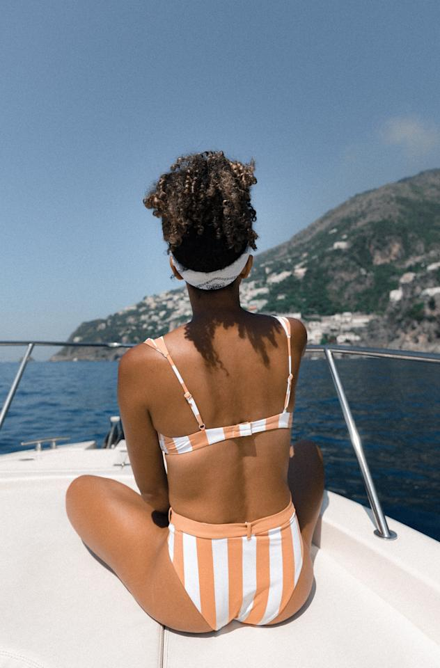 "<h2>How Do I Know If My Swimsuit Fits Properly?</h2> <p>Short answer: there should be no adjusting. If you're constantly pulling up straps or having to re-tie tie bottoms, something is wrong. MaryAnn, a merchandiser from Net-a-Porter suggests moving around in the suit before purchasing. ""Squat, lunge, walk. Whatever you can in the suit and notice what moves and what doesn't,"" she says. The goal is for nothing to move. You don't want the bathing suit to slide and you don't want to readjust between movements. If you do, the suit doesn't fit.</p> <h2>I'm In Between Sizes, Should I Size Up or Down?</h2> <p>Sizing up could result in a saggy fit. Sizing down could result in too tight of a fit. So what do you do? It depends on what you plan to do in the swim suit. Are you more of a reader and sun tanner who uses a bathing suit as an accessory? Or do you swim and enjoy recreational sports while in your swimsuit? ""Swim fabrics stretch when wet, so staying true to size or sizing down is best when you're in the water,"" Tyler Conrad from Summersalt swim told me. If you stay on the drier side, sizing up could be beneficial to make you feel more comfortable and secure in your suit.</p> <h2>How Can I Get My Straps to Stop Falling?</h2> <p>Regardless of how adjustable straps can be, my small shoulders never seem to hold them up properly. If you're like me, opt for ""racerbacks or halter tops where the crossing or tying will hold the bathing suit and straps in place,"" Tyler says. </p>"