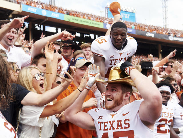 FILE - In this Oct. 6, 2018, file photo, Texas tight end Andrew Beck (47) wears the Golden Hat and celebrates with fans after defeating Oklahoma 48-45 in an NCAA college football game at the Cotton Bowl in Dallas. No. 5 Oklahoma and No. 9 Texas are playing in a rare Red River rivalry rematch in the Big 12 championship game on Saturday. It is the first time in 115 years that the border state rivals will play twice in the same season. (AP Photo/Cooper Neill, File)