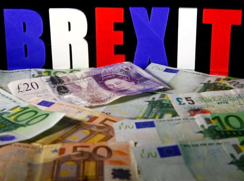 FILE PHOTO: Euro and Pound banknotes are seen in front of BREXIT letters in this picture illustration