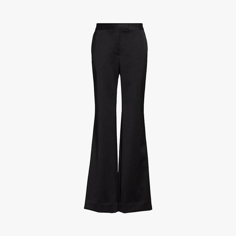 "$650, SAKS FIFTH AVENUE. <a href=""https://www.saksfifthavenue.com/product/marina-moscone-slim-flare-wool-blend-trousers-0400012342250.html?dwvar_0400012342250_color=BLACK"" rel=""nofollow noopener"" target=""_blank"" data-ylk=""slk:Get it now!"" class=""link rapid-noclick-resp"">Get it now!</a>"