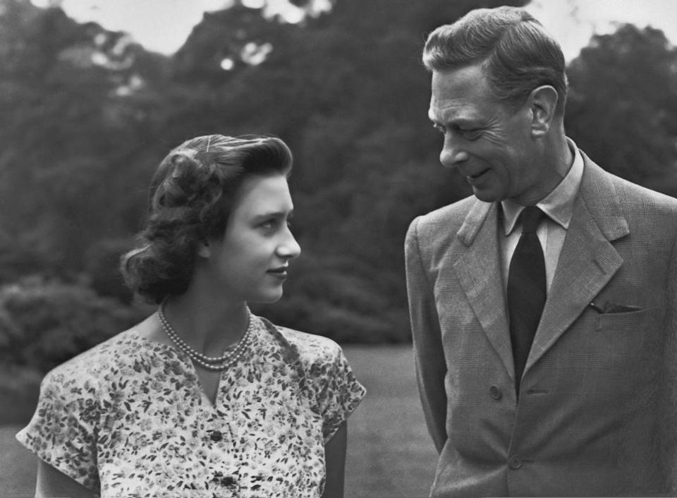 <p>A tender father-daughter moment between Margaret and King George VI while walking the grounds of Windsor Castle.</p>