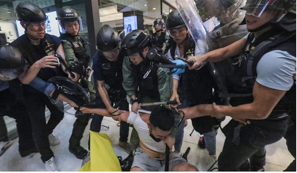 There were a number of clashes between police and protesters in the New Town Plaza shopping centre. Photo: Felix Wong