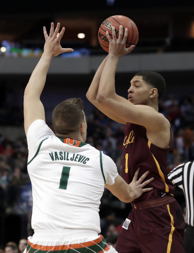 Miami guard Dejan Vasiljevic (1) defends as Loyola-Chicago guard Lucas Williamson (1) looks to make a pass in the first half of a first-round game at the NCAA college basketball tournament in Dallas, Thursday, March 15, 2018. (AP Photo/Tony Gutierrez)