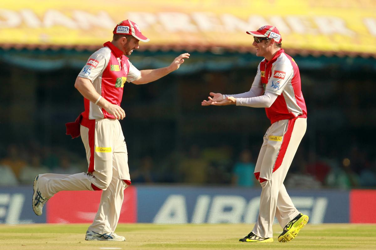 Shaun Marsh is congratulated by David Hussey after taking the catch to dismiss Wriddhiman Saha off the bowling of Parvinder Awanaduring match 45 of the Pepsi Indian Premier League between The Chennai Super Kings and the Kings XI Punjab held at the MA Chidambaram Stadium in Chennai on the 2nd May 2013. Photo by Jacques Rossouw-IPL-SPORTZPICS    .. .Use of this image is subject to the terms and conditions as outlined by the BCCI. These terms can be found by following this link:..https://ec.yimg.com/ec?url=http%3a%2f%2fwww.sportzpics.co.za%2fimage%2fI0000SoRagM2cIEc&t=1503352969&sig=zfO5s5L9IomikGVsDWkIug--~D
