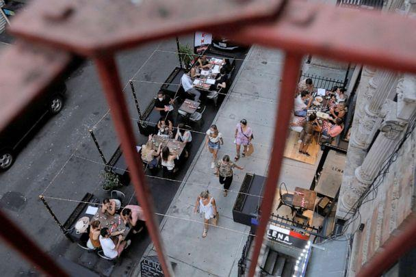 PHOTO: People eat outside of LENA Winebar as restaurants are permitted to offer al fresco dining as part of phase 2 reopening during the coronavirus disease (COVID-19) outbreak in the Lower East Side of New York City, June 27, 2020. (Andrew Kelly/Reuters)