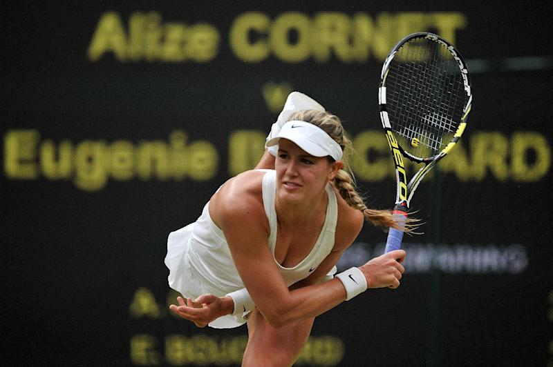 Canada's Eugenie Bouchard serves against France's Alize Cornet during their women's singles fourth round match on day seven of the 2014 Wimbledon Championships at The All England Tennis Club in Wimbledon, southwest London, on June 30, 2014