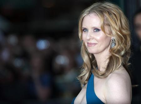 """Actress Cynthia Nixon poses for photographers at the premiere of """"Sex and the City 2"""" in London"""